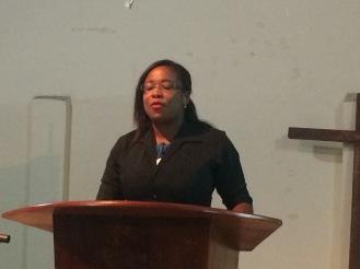 Veronica sharing during worship.